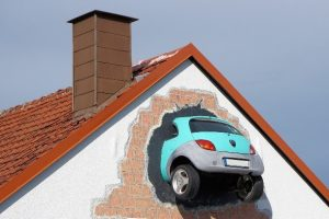 Image car in the side of a house